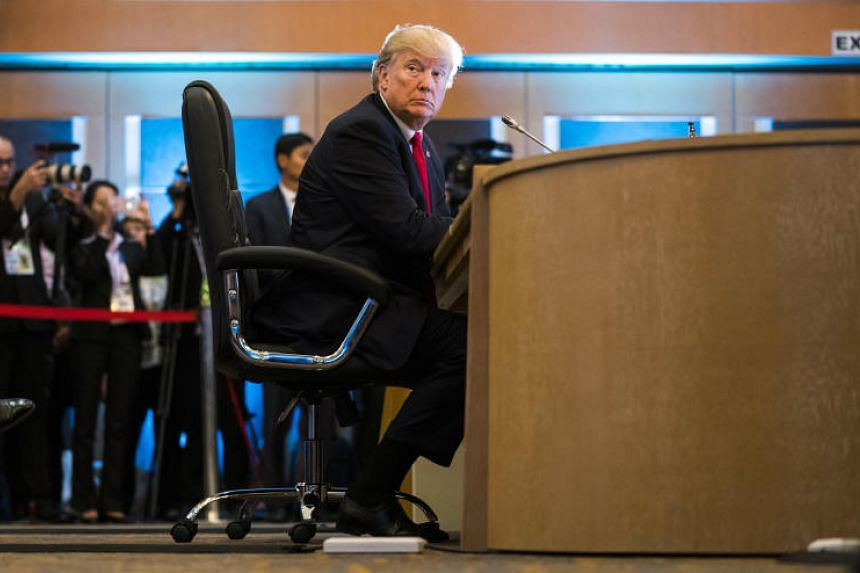 President Donald Trump listens during the Association of Southeast Asian Nations summit meeting in Manila on Nov 13, 2017.
