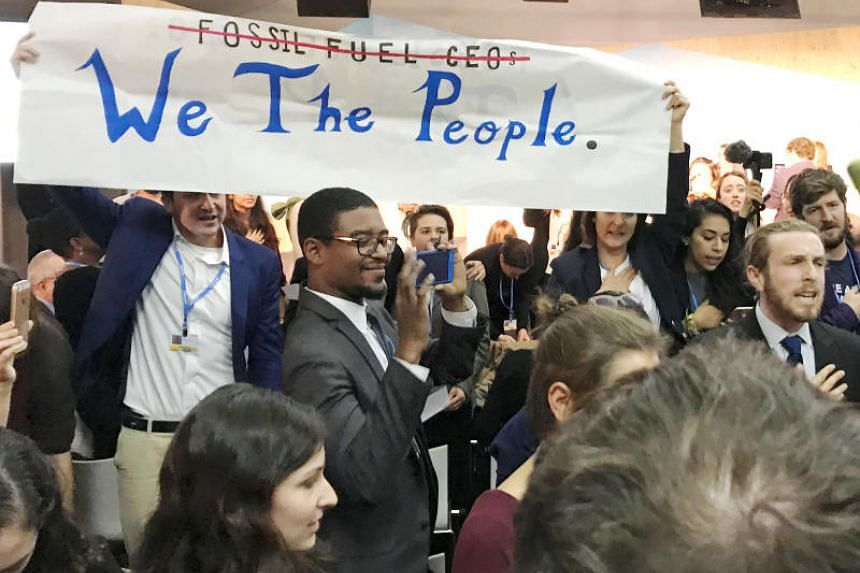 Protesters interrupt a US government pro-coal event during the COP23 UN Climate Change Conference 2017, hosted by Fiji but held in Bonn, Germany, on Nov 13, 2017.