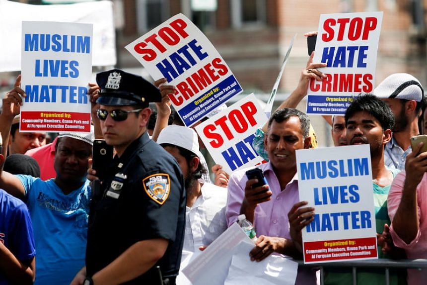 Community members take part in a protest to demand stop hate crime in the Queens borough of New York City, on Aug 15, 2016.