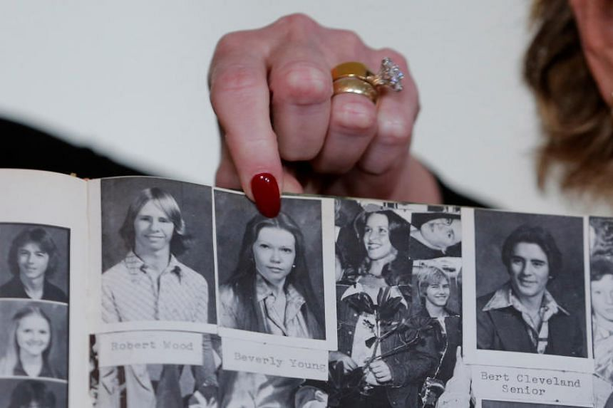 Accuser Beverly Young Nelson points to a photograph of herself in her high school yearbook after making a statement claiming that Alabama senate candidate Roy Moore sexually harassed her when she was 16, in New York, US on Nov 13, 2017.