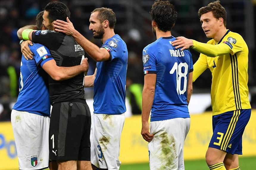 (From left) Italy's Andrea Barzagli, Gianligi Buffon, Giorgio Chiellini and Marco Parolo show their dejection at the end of the match against Sweden.