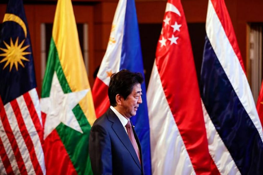 Japanese Prime Minister Shinzo Abe arrives for the 20th Asean Japan Summit in Manila.