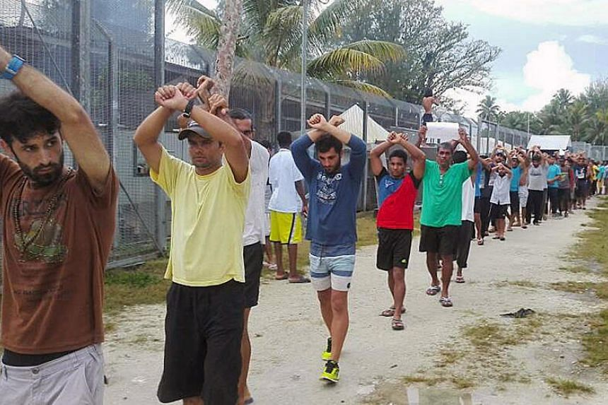 Detainees staging a protest inside the compound at the Manus Island detention centre in Papua New Guinea.