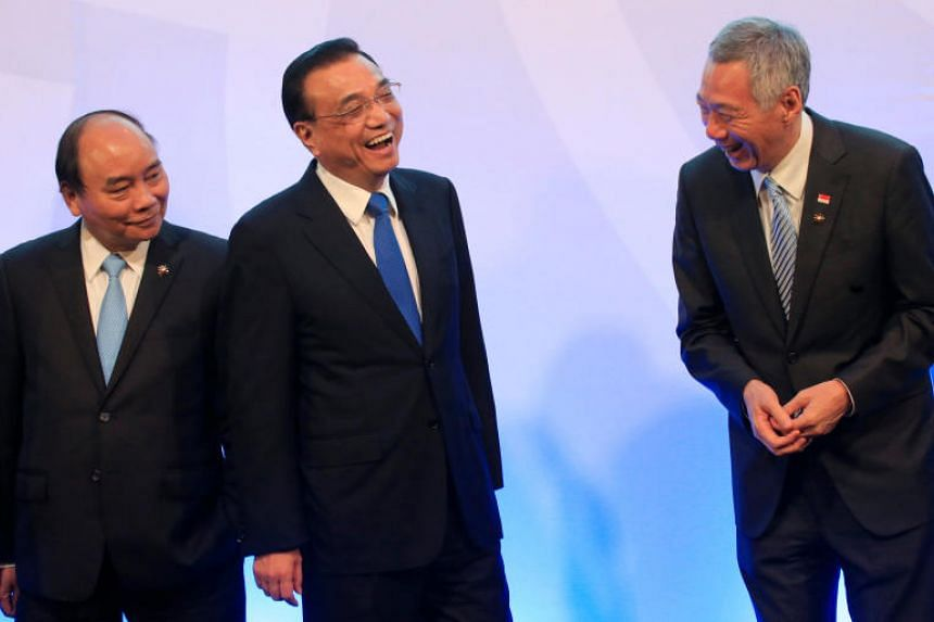 Chinese Premier Li Keqiang shares a light moment with Singapore's Prime Minister Lee Hsien Loong while Vietnam's Prime Minister Nguyen Xuan Phuc looks on during the 20th Asean-China Summit in Manila.