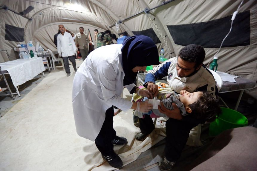 A child receives medical treatment at a temporary hospital in the city of Pole-Zahab in Kermanshah Province, Iran.