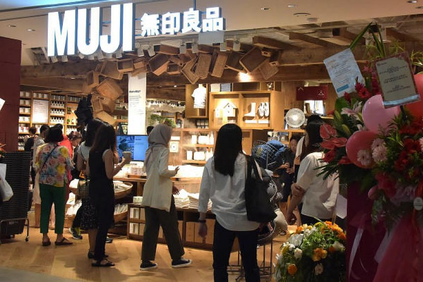 Customers at the Muji store in Plaza Singapura, the lifestyle brand's first flagship store in South-east Asia.