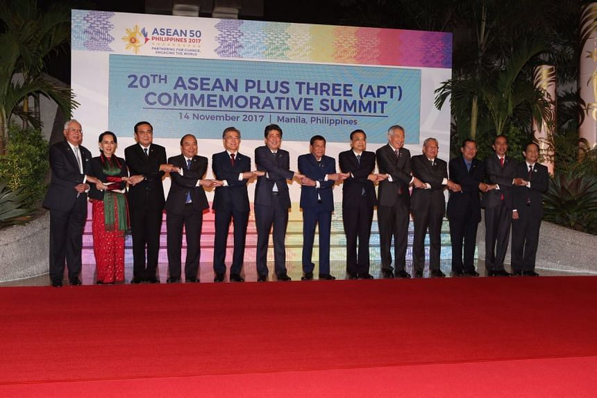 Asean leaders pose for a group photo during the 20th Asean-China Summit.