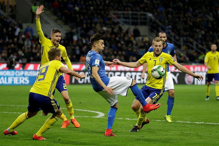 Italy's Stephan El Shaarawy in action with Sweden's Sebastian Larsson at the 2018 World Cup Qualifications in San Siro, Milan, Italy on Nov 13, 2017.