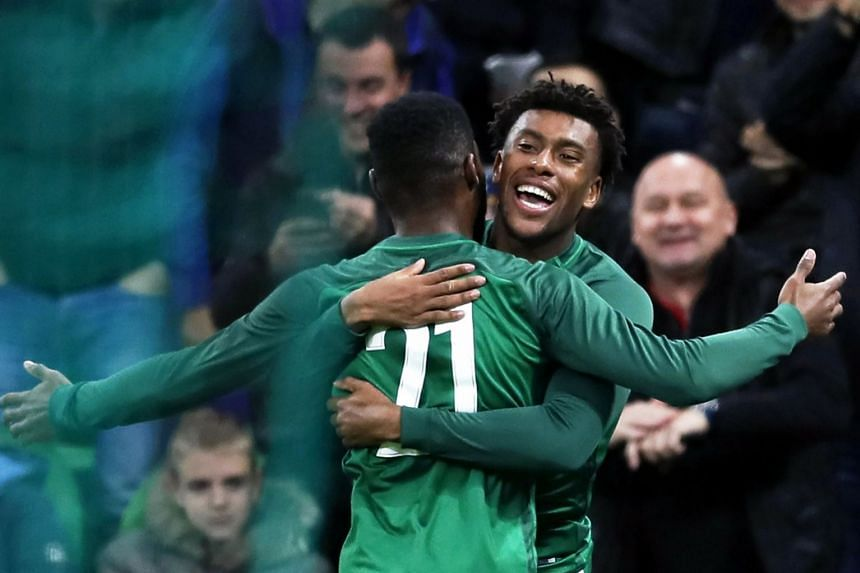Alex Iwobi (right) celebrates with team mate Brian Idowu after scoring the 2-2 equaliser.