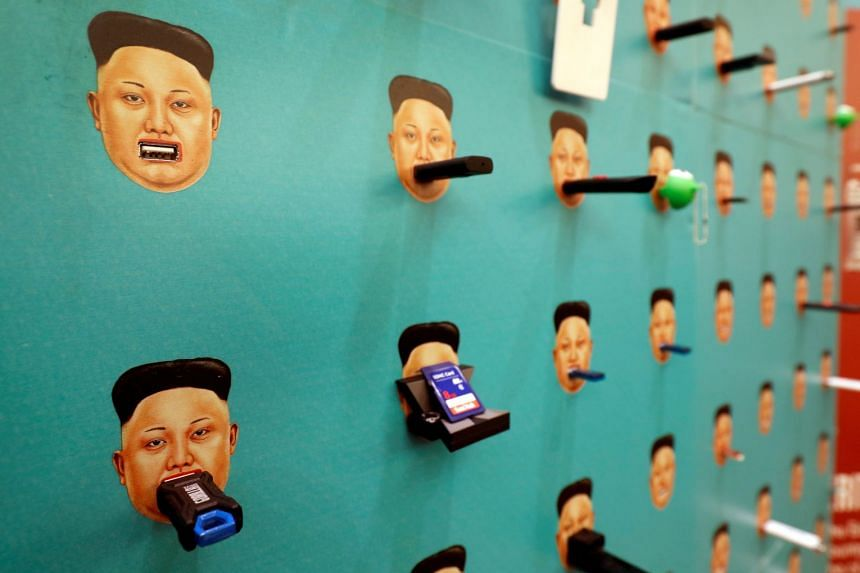 Donated flash drives with images of North Korean leader Kim Jong-un at the Def Con hacker convention in July 2017.