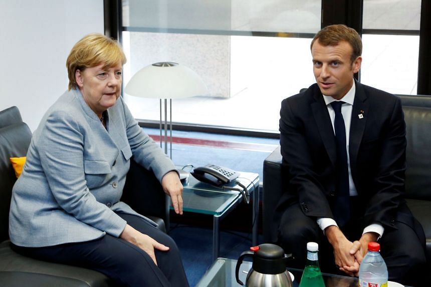 """Along with UN chief Antonio Guterres, French President Emmanuel Macron (right) and German Chancellor Angela Merkel (left) will kick off Wednesday a day-and-a-half of back-to-back """"high-level"""" speeches."""