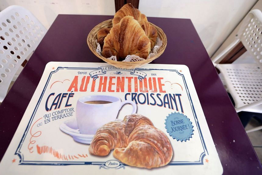 """All-butter croissants are displayed on a table at the bakery """"Le Capitole"""" in Nice, France, on Oct 25, 2017."""