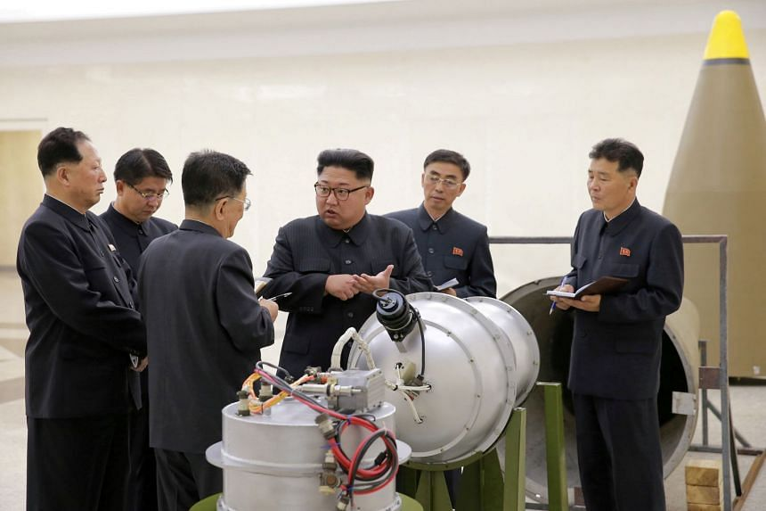 North Korean leader Kim Jong Un provides nuclear weapons guidance in a photo released September 2017.