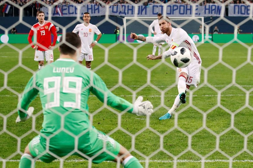 Spain's Sergio Ramos scores their third goal from the penalty spot.
