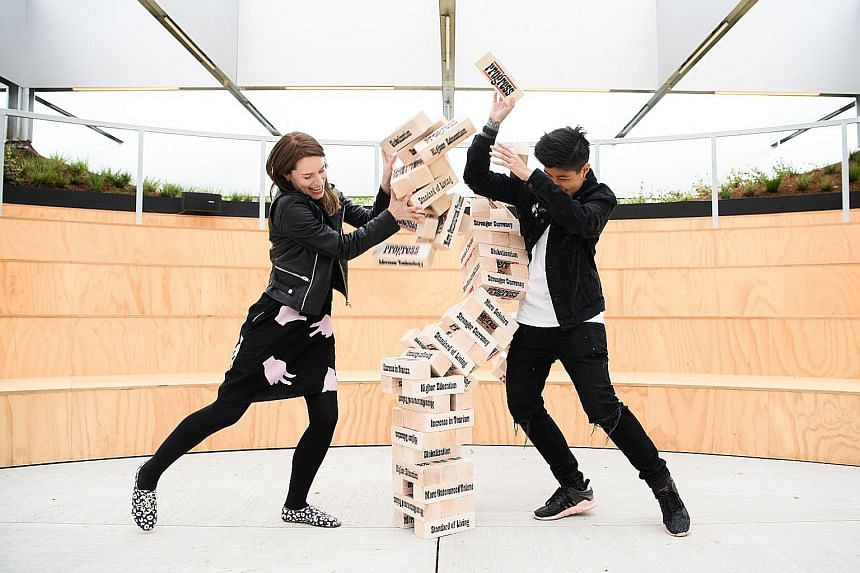 The block-stacking sculpture, Progress: The Game Of Leaders (above); and the art film, 5 Rehearsals For A Wedding (below).