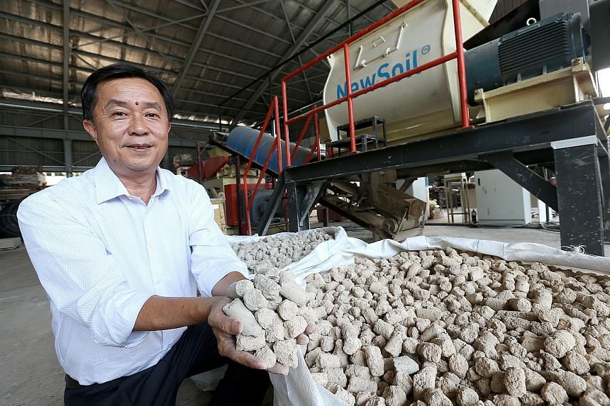 New Soil Technologies founder and managing director Phua Lam Soon with the new earth or New Soil that has been treated so it can be used for land reclamation.