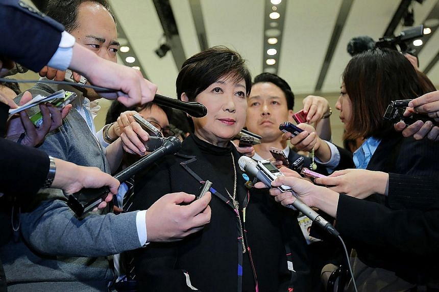 Ms Yuriko Koike speaking to reporters after saying she will step down as leader of Party of Hope in Tokyo yesterday. Ms Koike will be in Singapore for a three-day visit from today as part of the Lee Kuan Yew Exchange Fellowship programme.