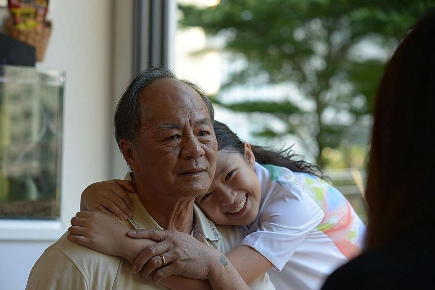 Before We Forget, by film-maker Jess Teong (above), stars Ti Lung as grandfather Gen and Tan Qin Lin as his granddaughter Sarah (both left).