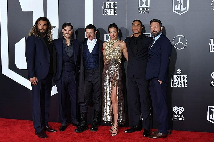 Superhero actors (from left) Jason Momoa (Aquaman), Henry Cavill (Superman), Ezra Miller (The Flash), Gal Gadot (Wonder Woman), Ray Fisher (Cyborg) and Ben Affleck (Batman) reunited at the world premiere of their film, Justice League, in Los Angeles