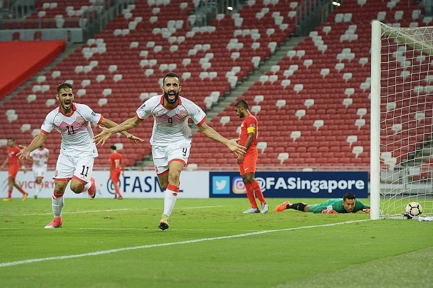 Striker Mahdi Abduljabbar (No. 9) celebrating scoring Bahrain's first goal as Singapore goalkeeper Hassan Sunny and skipper Hariss Harun look on helplessly. The Lions can no longer qualify for the 2019 Asian Cup.
