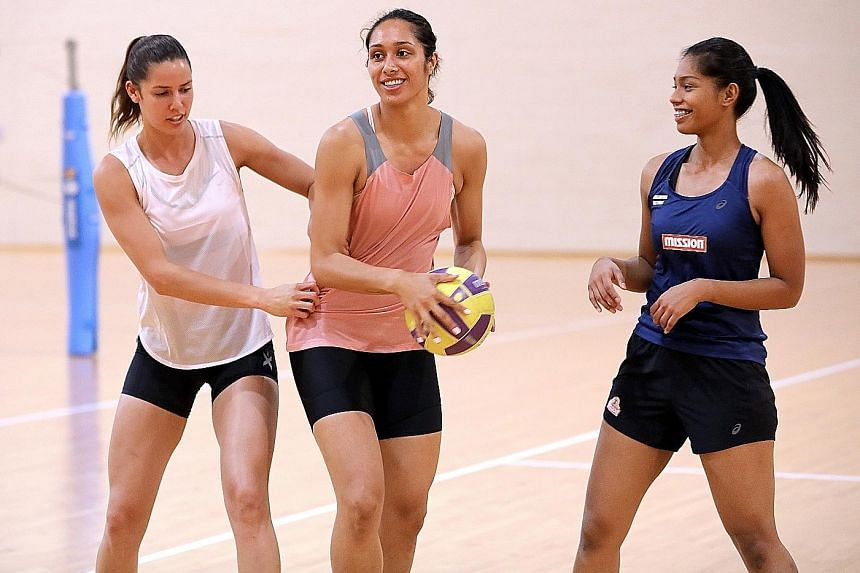 From left: Silver Ferns players Kayla Cullen and Phoenix Karaka with national netballer Aqilah Andin during a training session at the OCBC Arena yesterday. The two New Zealand players were in town for last Saturday's M1 Corporate Netball Challenge, a
