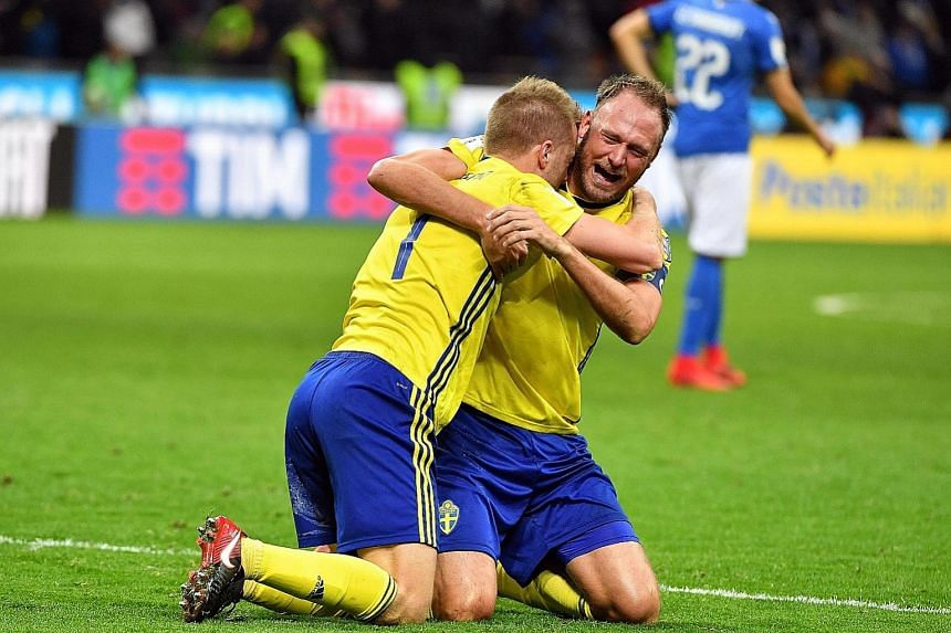 Sweden captain Andreas Granqvist (right) and midfielder Sebastian Larsson celebrating at the San Siro on Monday after securing their passage to Russia 2018 at the expense of four-time world champions Italy.