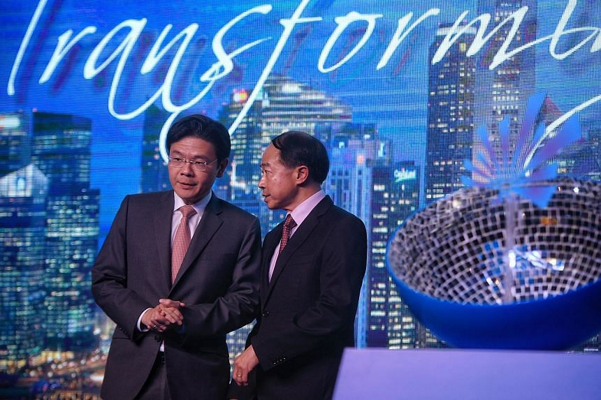 National Development Minister Lawrence Wong with Redas president Augustine Tan during the association's 58th anniversary dinner last night.