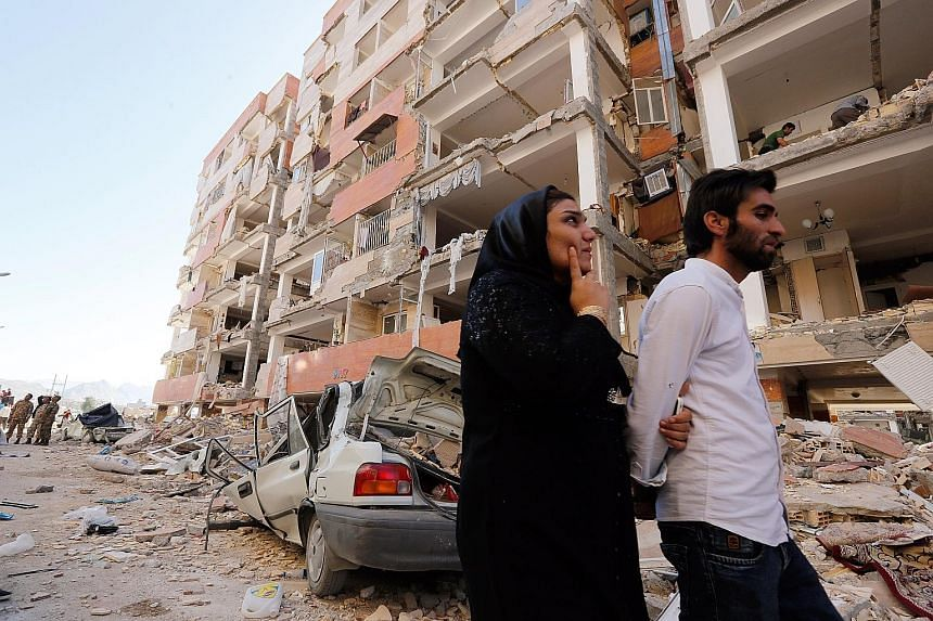 Damaged buildings in Sarpol-e Zahab, one of the hardest-hit towns, in Iran's Kermanshah province following Sunday's earthquake. At least 14 provinces were affected by the quake, which destroyed two whole villages, damaged 30,000 houses and left more