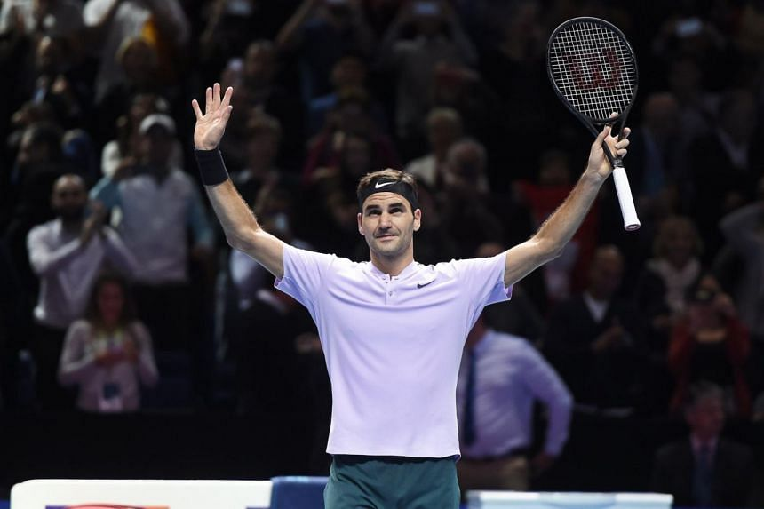 Roger Federer of Switzerland celebrates after defeating Alexander Zverev of Germany in their round robin match of the ATP World Tour Finals tennis tournament in London, Britain, on Nov 14, 2017.