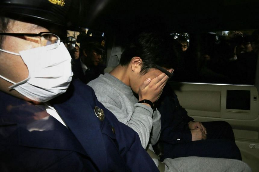 """The suspect, Takahiro Shiraishi (centre), dubbed the """"Twitter killer"""", reportedly lured his victims - aged between 15 and 26 - by trawling social media, and the gruesome discovery has prompted the government to consider tightening internet regulation"""