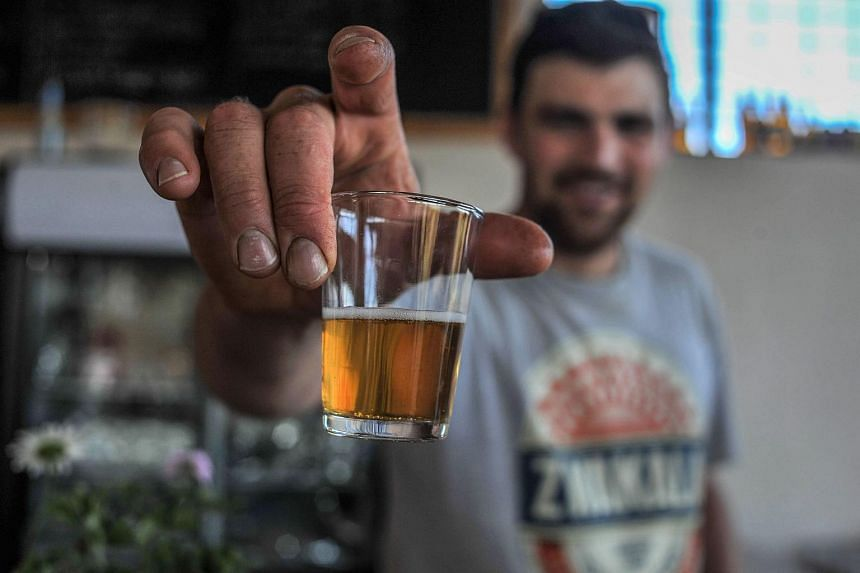 Luca Tooley, founder of Zwakala craft beer made in Limpopo, shows his award winning beer at the Zwakala brewery in Haenertsburg, South Africa, on Oct 19, 2017.