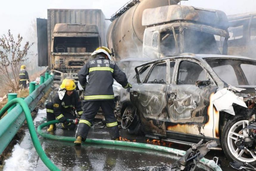 Firemen at the site of an accident on an expressway in Fuyang in central China's Anhui province, on Nov 15, 2017.