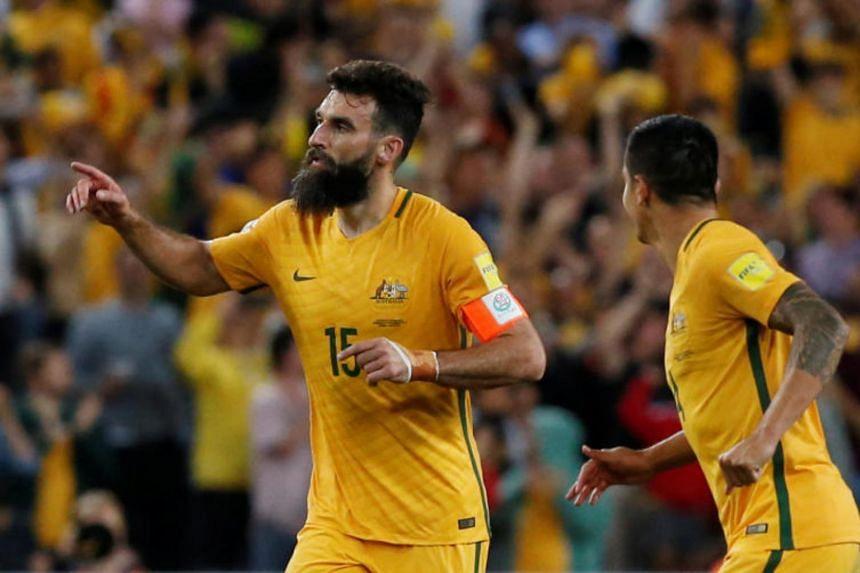 Australia's Mile Jedinak celebrates scoring a goal.