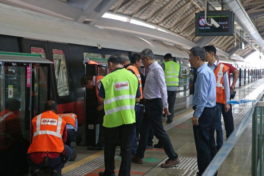 SMRT staff inspecting an affected train on platform B after 2 trains collide at Joo Koon MRT station on the morning of Nov 15, 2017.