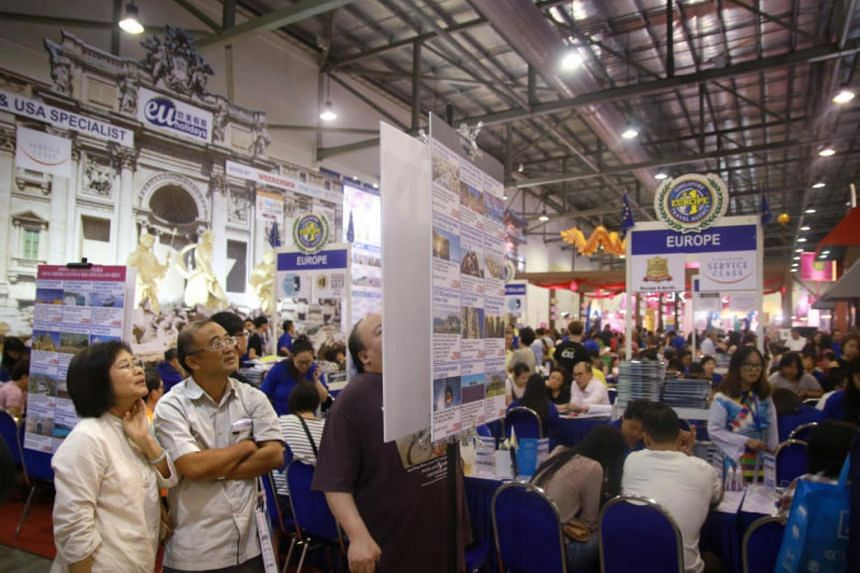 Visitors to the National Association of Travel Agents Singapore (Natas) travel fair at the Singapore Expo on Feb 18, 2017.