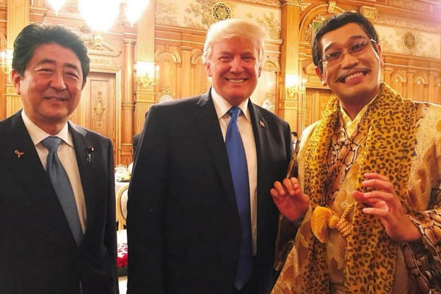 Japanese pop star Pikotaro (right) poses with Japan's Prime Minister Shinzo Abe and US President Donald Trump during an official dinner in Trumps honour at Akasaka Palace in Tokyo, Japan on Nov 6, 2017.