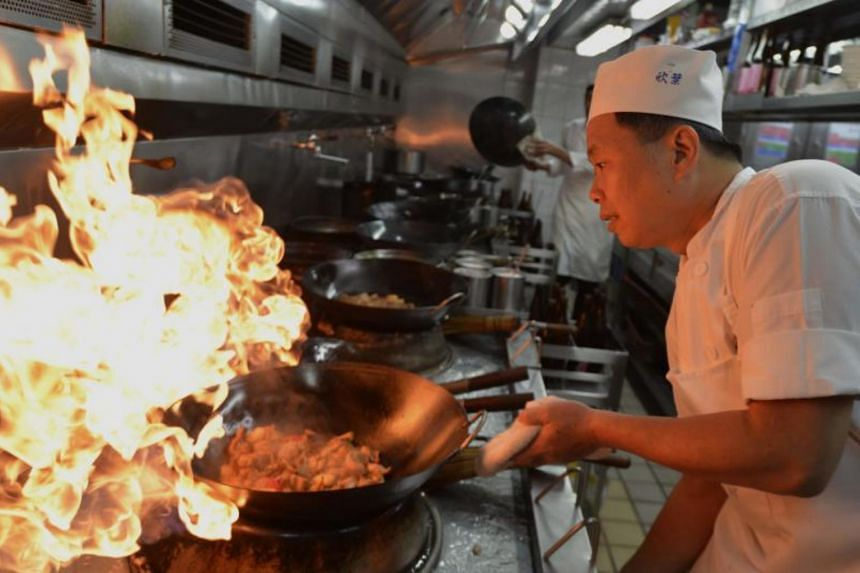 A chef of Shin Yeh restaurant cooking in the kitchen in Taipei on Oct 30, 2017.