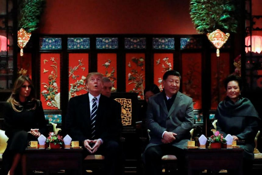 US President Donald Trump, US first lady Melania, China's President Xi Jinping and China's First Lady Peng Liyuan watch an opera performance at the Forbidden City in Beijing, China, Nov 8, 2017.