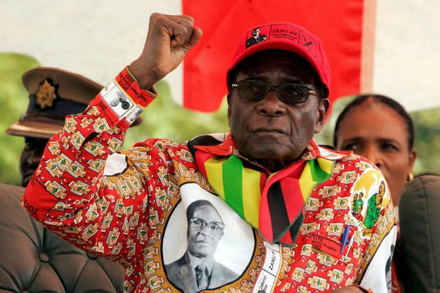 Zimbabwe's President Robert Mugabe gestures at an election rally in the small town of Shamva northeast of the capital Harare, on May 29, 2008.