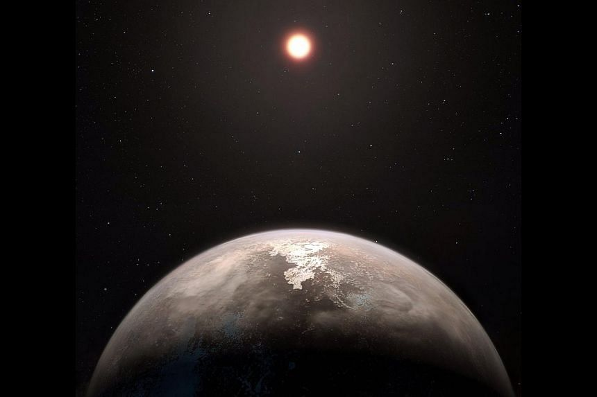 An artist's impression of planet Ross 128b, with its red dwarf parent star in the background.