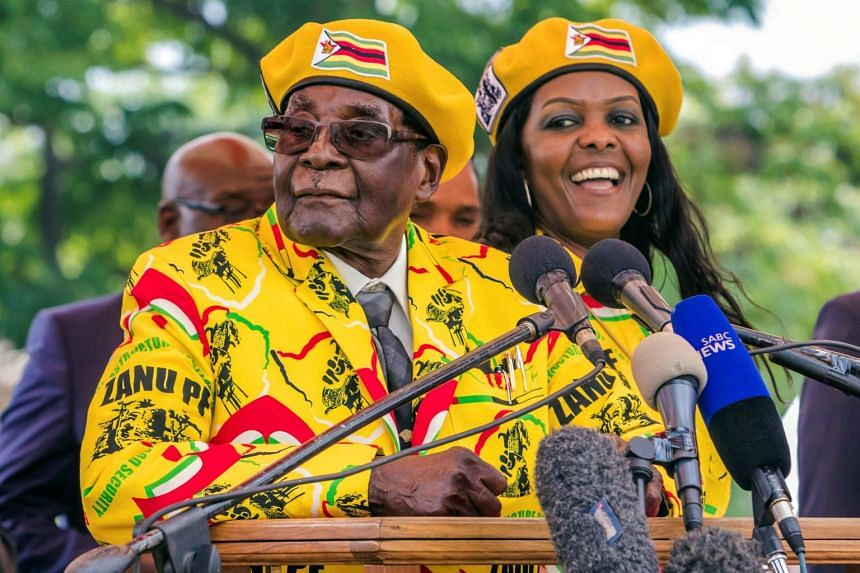 President Mugabe (left) shows support for wife Grace (right) becoming the party's next vice-president.