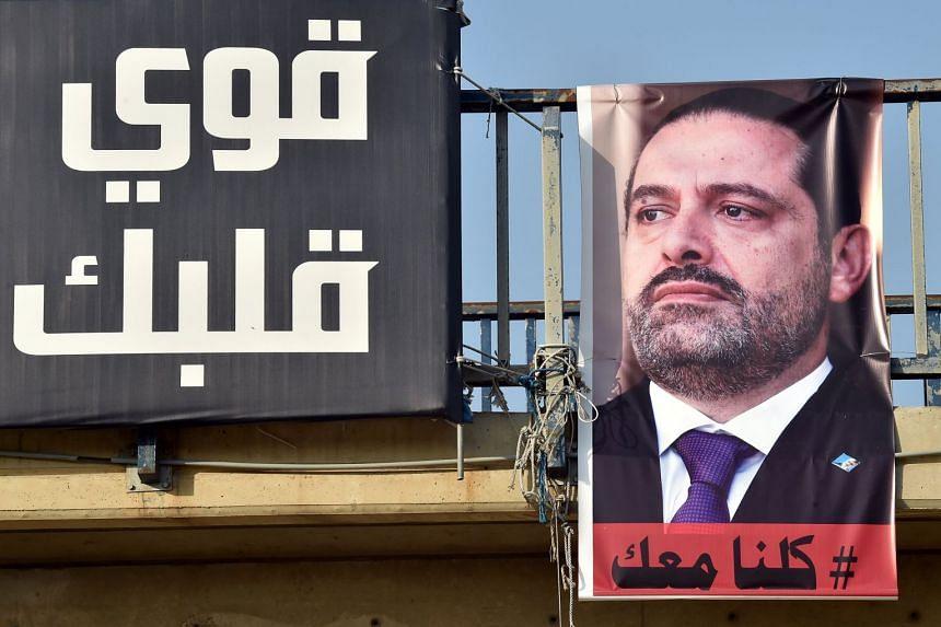 A poster depicting Saad Hariri (right) in Beirut, Lebanon, Nov 14, 2017.