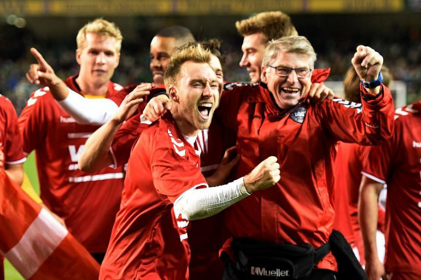 Christian Eriksen celebrates with the Denmark team after the match.