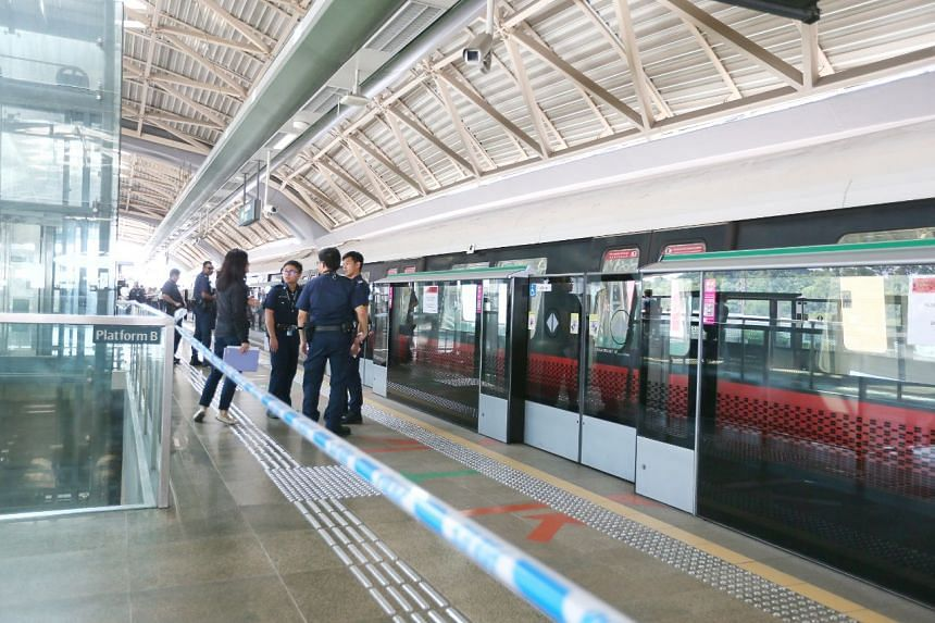 Police officers cordoned off a section of the platform after an SMRT train hit a stationary train.