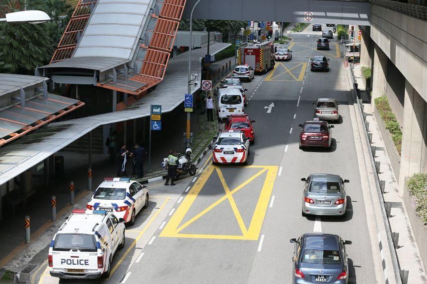 Police vehicles at the scene at Joo Koon MRT station.