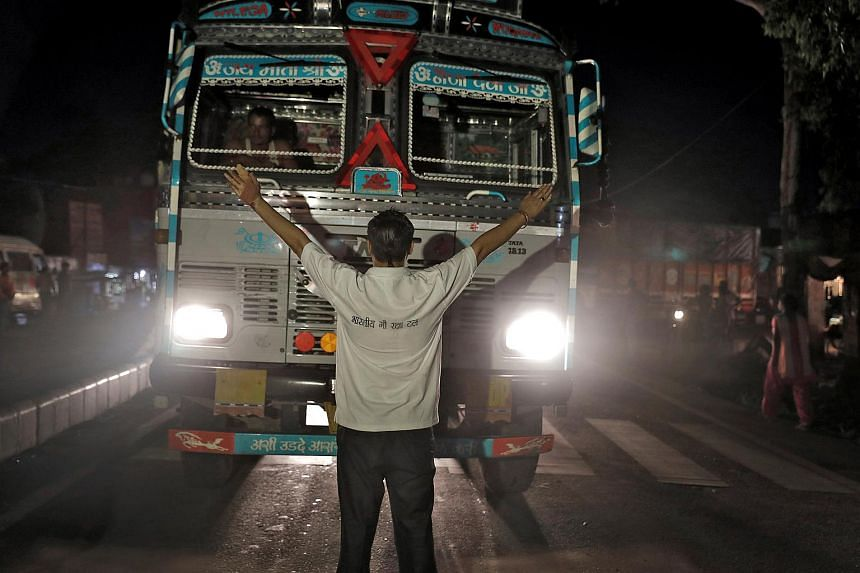 A cow vigilante stops a lorry at a road block near Chandigarh, India, on July 6, 2017.