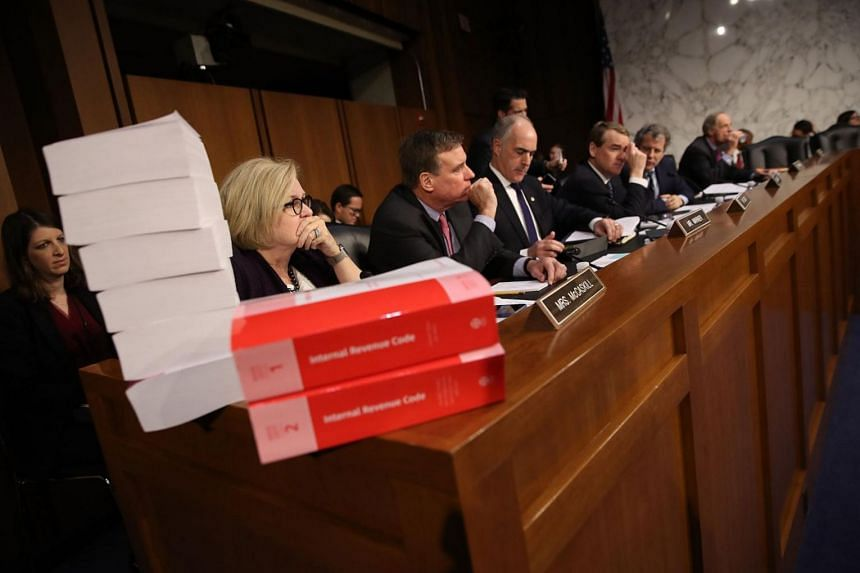 Members of the Senate Finance Committee participate in a markup of the Republican tax reform proposal in Washington, DC.