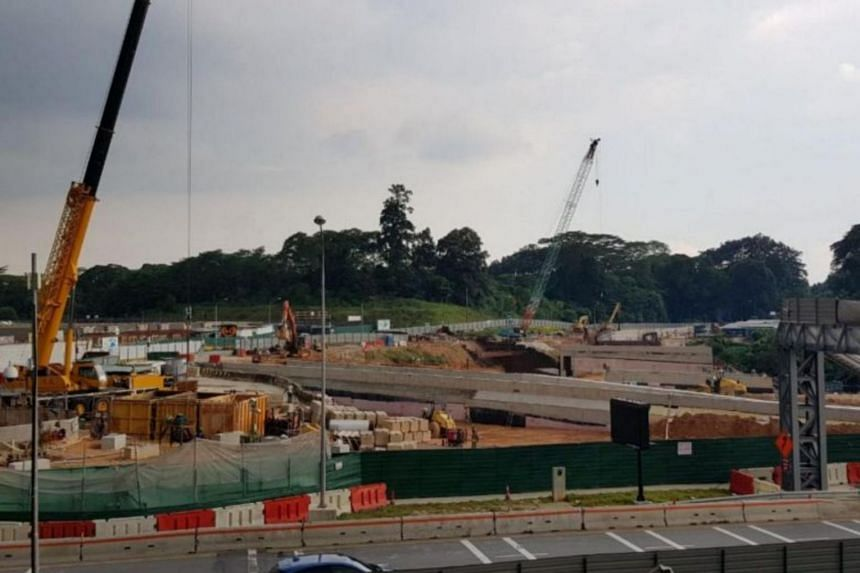 The 2km road has been delayed because the main contractor is facing financial difficulties.