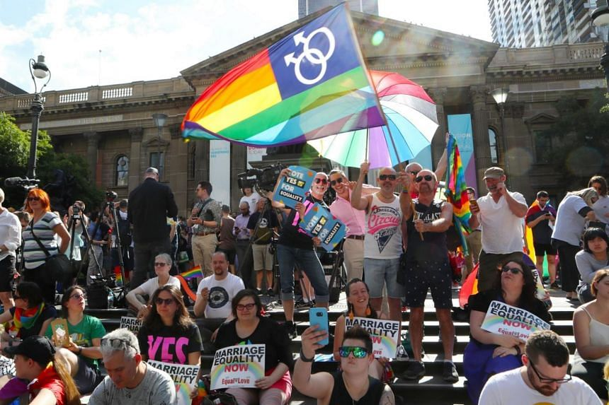 People gather in front of Melbourne's State Library of Victoria for the outcome of the same-sex marriage vote.