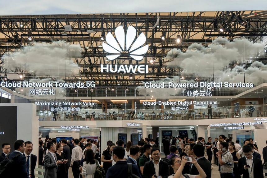 Visitors are seen at the Huawei stand during the 2017 Mobile World Congress in Shanghai, China.